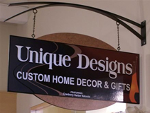 Unique Designs store sign